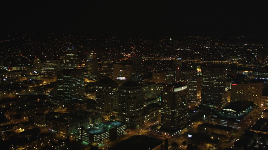 5K stock footage aerial video Fly over high rises, and tilt to Oakland Tribune Tower, Downtown Oakland, California, night Aerial Stock Footage | DCSF06_093