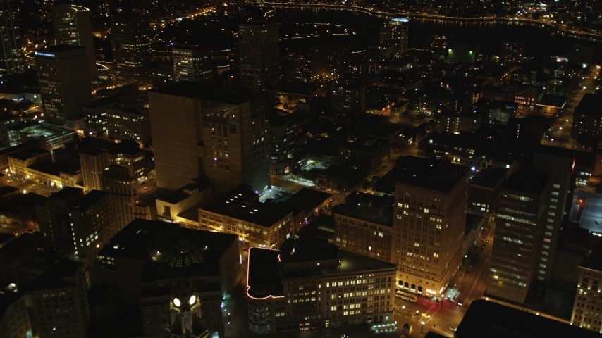 5K stock footage aerial video Flying over high-rises toward Lake Merritt, Downtown Oakland, California, night Aerial Stock Footage | DCSF06_094