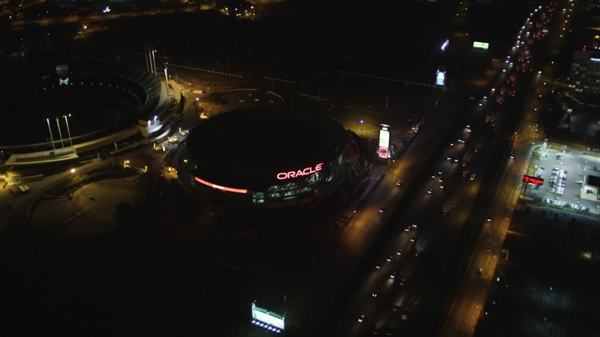 5K stock footage aerial video Fly over Interstate 880, tilt to Oracle Arena by O.co Coliseum, Oakland, California, night Aerial Stock Footage | DCSF06_101