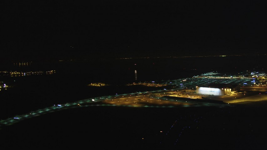 5K stock footage aerial video Track a small plane landing at Oakland International Airport, Oakland, California, night Aerial Stock Footage | DCSF06_102
