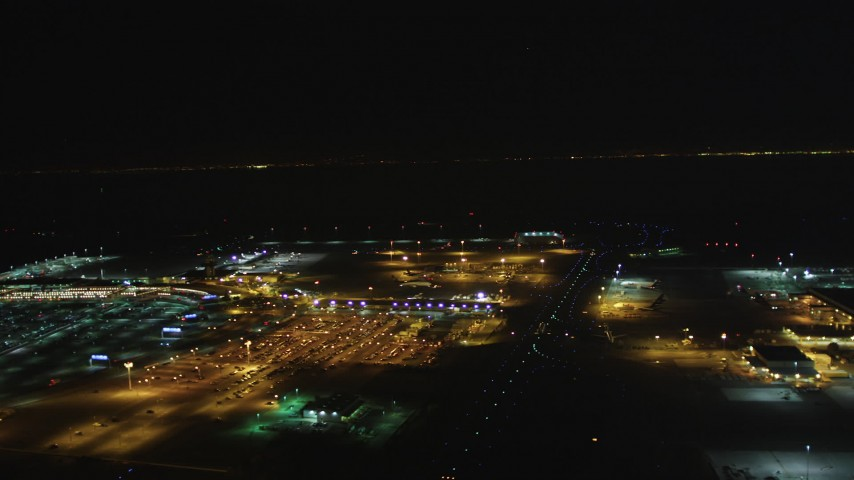 5K stock footage aerial video Flyby Oakland International Airport and the FedEx Terminal, Oakland, California, night Aerial Stock Footage | DCSF06_104