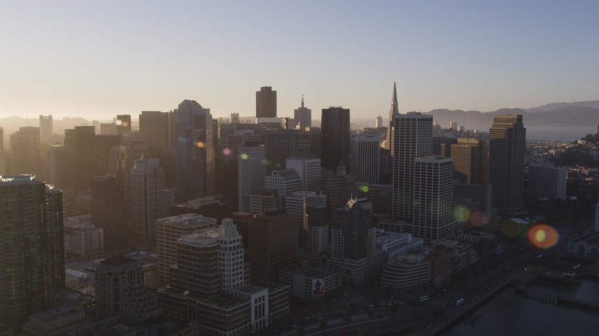 5K stock footage aerial video Fly over skyscrapers in Downtown San Francisco, California, sunset Aerial Stock Footage | DCSF07_003