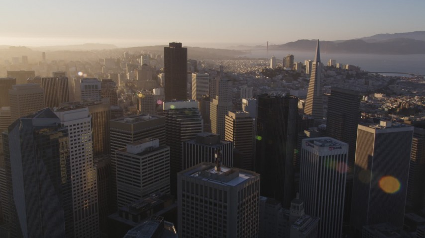 5K stock footage aerial video Fly over downtown and approach 555 California Street, Downtown San Francisco, California, sunset Aerial Stock Footage | DCSF07_004