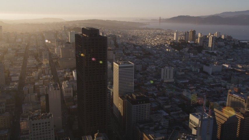 5K stock footage aerial video Fly past 555 California Street toward Nob Hill high-rises, Downtown San Francisco, California, sunset Aerial Stock Footage | DCSF07_005