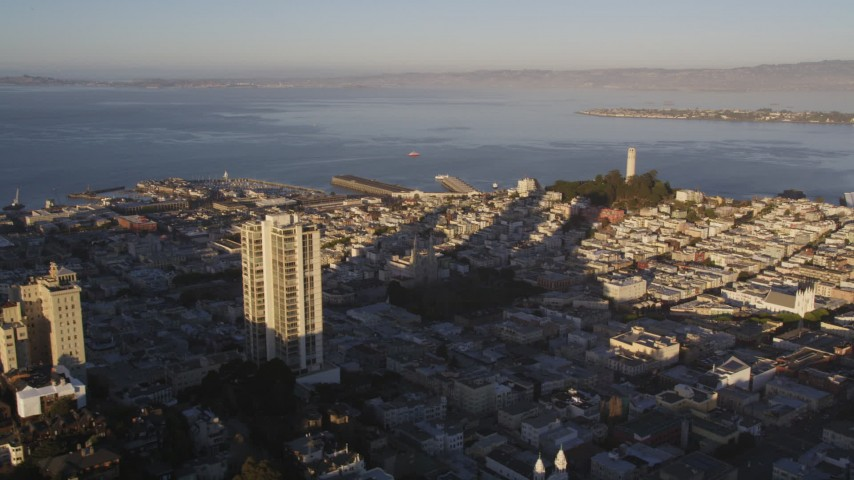 5K stock footage aerial video of A view of Coit Tower while flying by Russian Hill high-rises, San Francisco, California, sunset Aerial Stock Footage | DCSF07_006