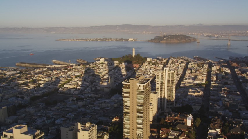5K stock footage aerial video of Coit Tower seen while flying by Russian Hill high-rises, San Francisco, California, sunset Aerial Stock Footage | DCSF07_007