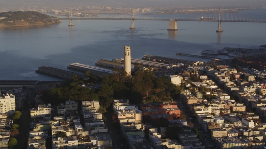5K stock footage aerial video Approach Coit Tower with Bay Bridge in background, North Beach, San Francisco, California, sunset Aerial Stock Footage | DCSF07_008