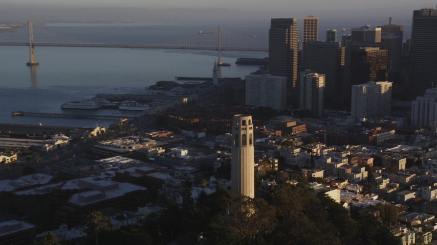 5K stock footage aerial video Flying by Coit Tower and the Financial District skyline, Downtown San Francisco, California, sunset Aerial Stock Footage | DCSF07_009