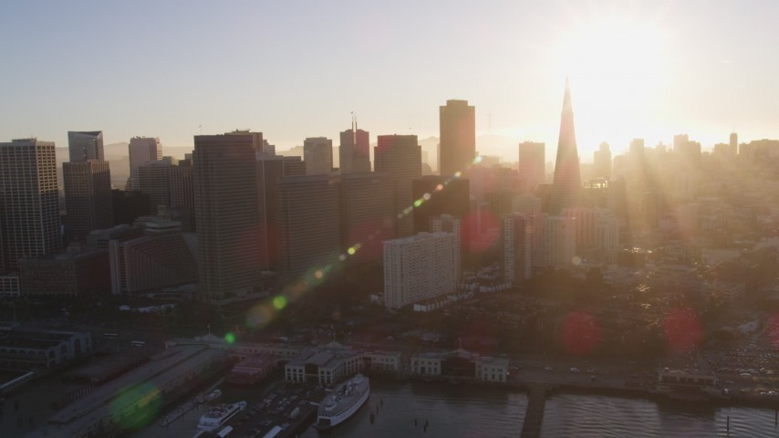 5K stock footage aerial video Reverse view of the Financial District skyline, San Francisco, California, sunset Aerial Stock Footage | DCSF07_010