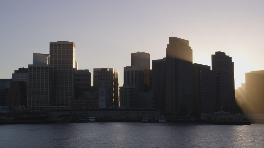 5K stock footage aerial video of The Ferry Building and skyline of Downtown San Francisco, California, sunset Aerial Stock Footage | DCSF07_012