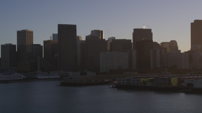 5K stock footage aerial video Flyby the downtown skyline, seen from piers on the bay, Downtown San Francisco, California, sunset Aerial Stock Footage | DCSF07_015