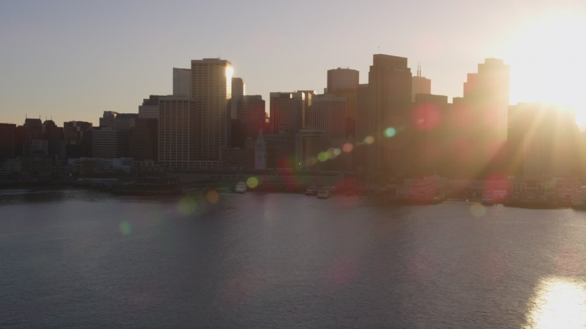 5K aerial video Setting sun over skyscrapers and Ferry Building, Downtown San Francisco, California, sunset Aerial Stock Footage | DCSF07_016