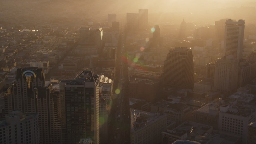 5K stock footage aerial video Follow Market Street through downtown with a hazy sunset, Downtown San Francisco, California Aerial Stock Footage | DCSF07_017