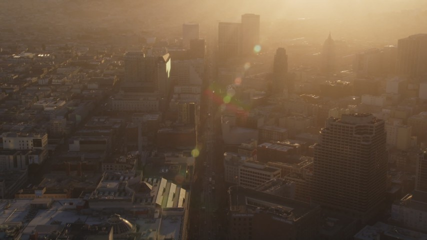 5K stock footage aerial video Fly over Market Street through Downtown San Francisco, California, hazy sunset Aerial Stock Footage | DCSF07_018