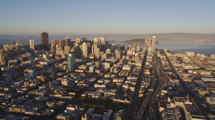 5K stock footage aerial video View of Financial District skyscrapers and Interstate 80, San Francisco, California, sunset Aerial Stock Footage | DCSF07_024