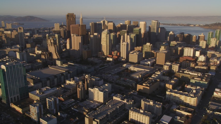 5K stock footage aerial video Tilt from I-80 to reveal and approach downtown skyscrapers, Downtown San Francisco, California, sunset Aerial Stock Footage | DCSF07_025