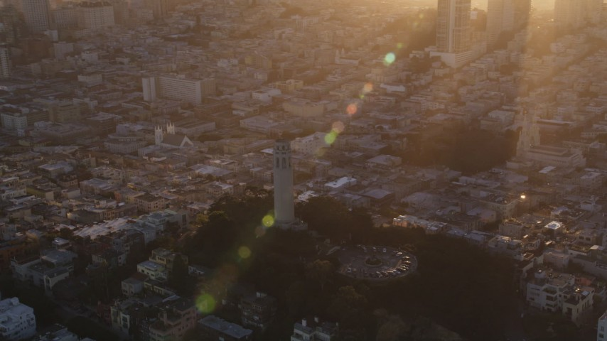 5K stock footage aerial video Orbit Coit Tower, tilt to reveal downtown skyline, Downtown San Francisco, California, sunset Aerial Stock Footage | DCSF07_029