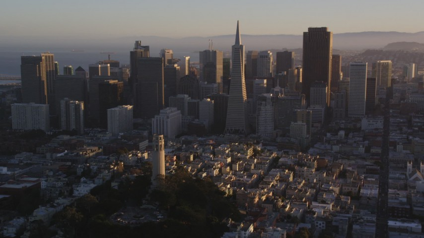 5K stock footage aerial video Flyby Coit Tower, Transamerica Pyramid and Downtown San Francisco, California, sunset Aerial Stock Footage | DCSF07_030