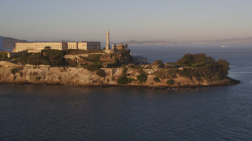 Low flyby the south end of Alcatraz, San Francisco, California, sunset Aerial Stock Footage | DCSF07_032
