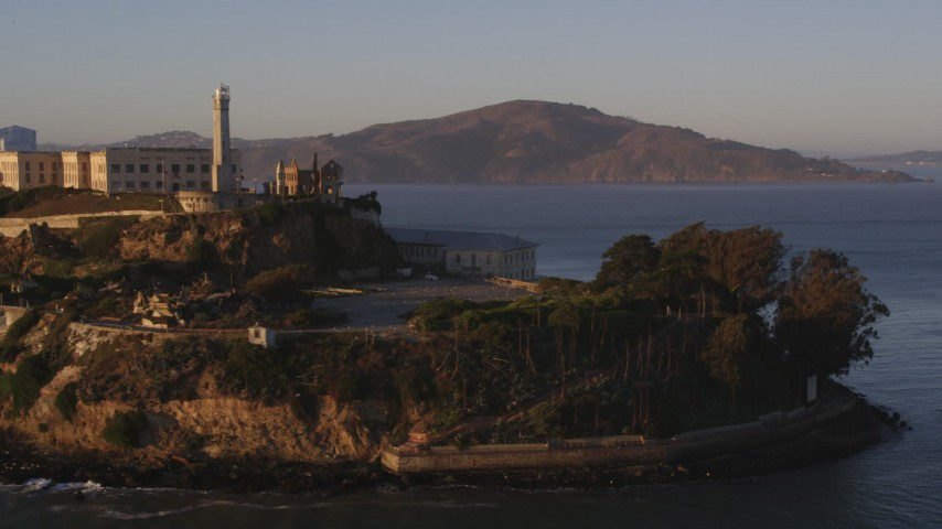 Low orbit of Alcatraz, San Francisco, California, sunset Aerial Stock Footage DCSF07_033