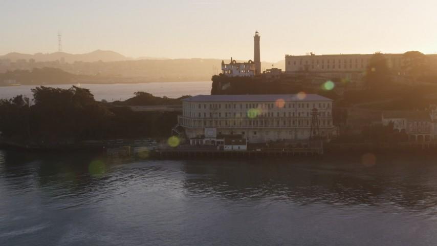 Low altitude orbit of Alcatraz, skyline in the background, San Francisco, California, sunset Aerial Stock Footage   DCSF07_035