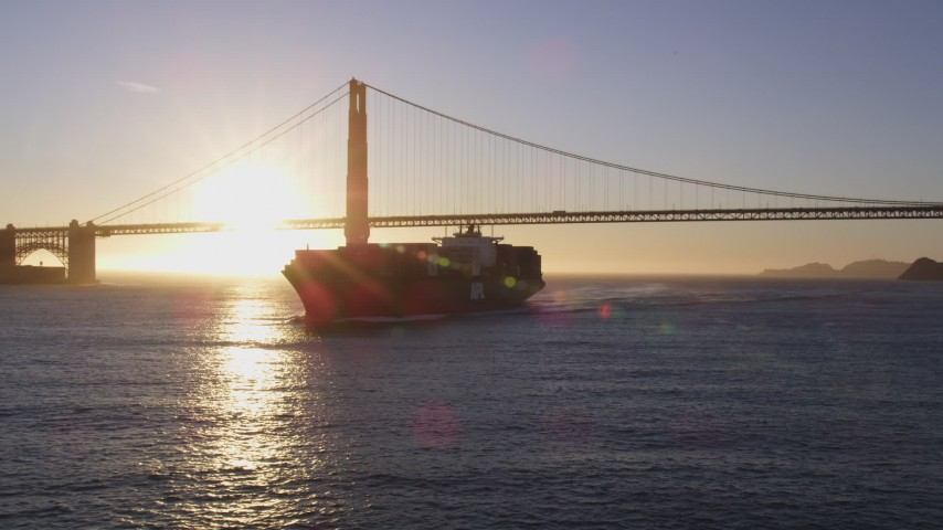 5K stock footage aerial video Low altitude flyby of a cargo ship near the Golden Gate Bridge, San Francisco, California, sunset Aerial Stock Footage | DCSF07_037