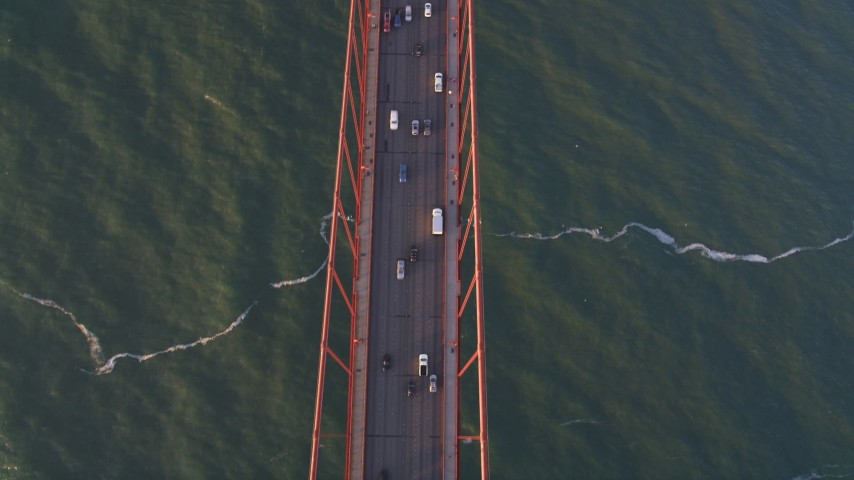 5K stock footage aerial video Bird's eye view of traffic on the Golden Gate Bridge, San Francisco, California, sunset Aerial Stock Footage | DCSF07_040