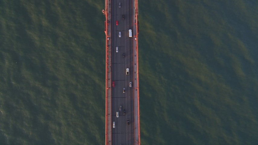 5K stock footage aerial video Bird's eye view of cars on the Golden Gate Bridge, San Francisco, California, sunset Aerial Stock Footage | DCSF07_041