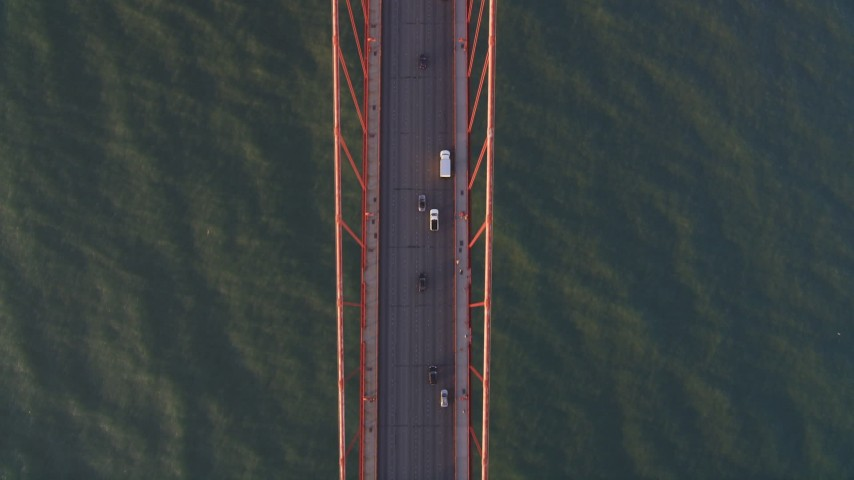 5K aerial video Bird's eye view of light traffic on the Golden Gate Bridge, San Francisco, California, sunset Aerial Stock Footage | DCSF07_042