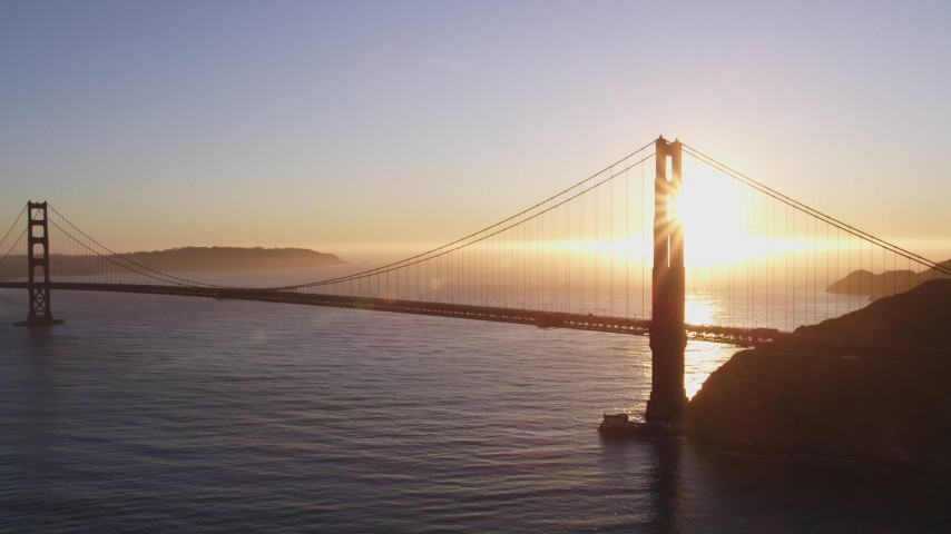 5K stock footage aerial video Flying by Golden Gate Bridge, San Francisco, California, sunset Aerial Stock Footage | DCSF07_044