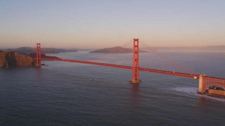 5K aerial video Flying by Golden Gate Bridge, San Francisco Bay, San Francisco, California, sunset Aerial Stock Footage | DCSF07_046