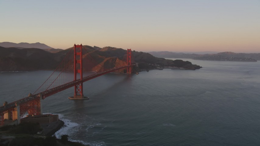 5K aerial video Flying by the Golden Gate Bridge, Marin Headlands in the background, San Francisco, California, sunset Aerial Stock Footage | DCSF07_052