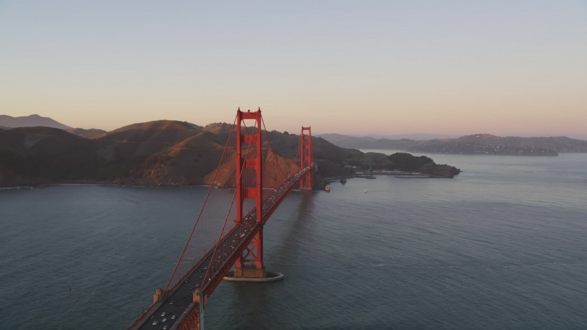 5K aerial video Passing the Golden Gate Bridge, Marin Headlands behind it, San Francisco, California, sunset Aerial Stock Footage | DCSF07_053