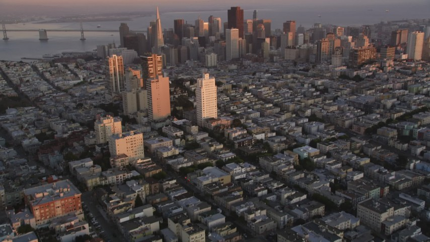 5K Aerial Video Tilt from Russian Hill apartment buildings to reveal Downtown San Francisco, California, twilight Aerial Stock Footage | DCSF07_057