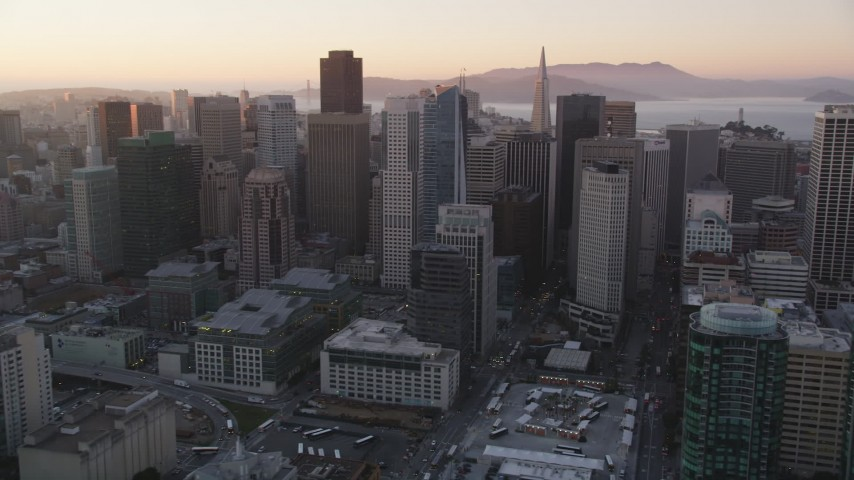5K Aerial Video Flying by skyscrapers, Downtown San Francisco, California, sunset Aerial Stock Footage | DCSF07_061