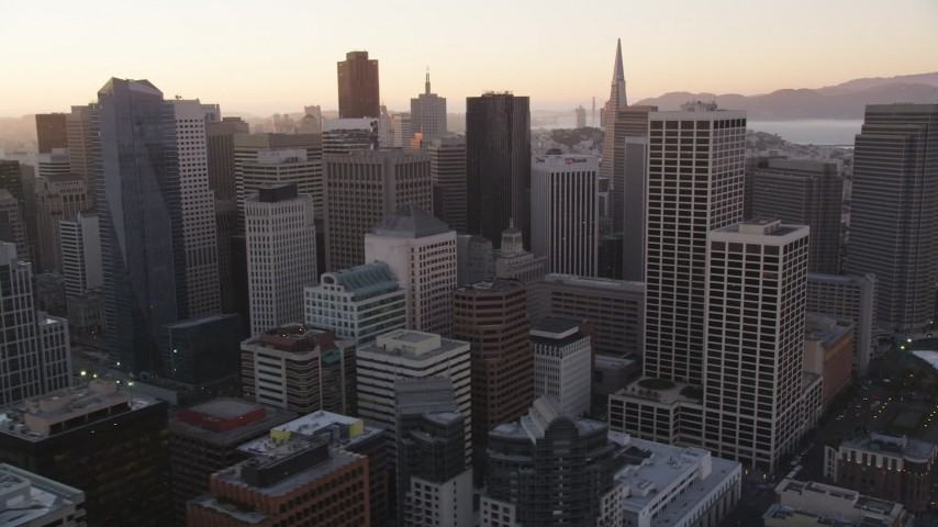 5K Aerial Video Flying by high-rises and skyscrapers, Downtown San Francisco, California, sunset Aerial Stock Footage | DCSF07_062
