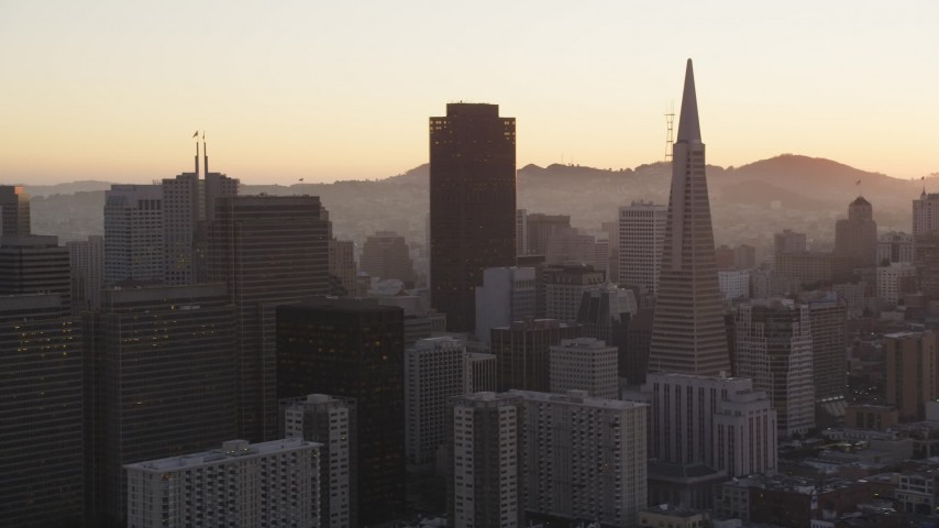 5K Aerial Video Flyby skyscrapers and Transamerica Pyramid, Downtown San Francisco, California, sunset Aerial Stock Footage | DCSF07_065
