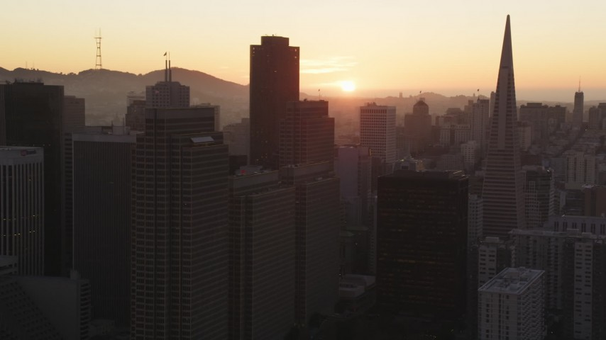 5K Aerial Video Flying skyscrapers, setting sun in background, Downtown San Francisco, California, sunset Aerial Stock Footage | DCSF07_066