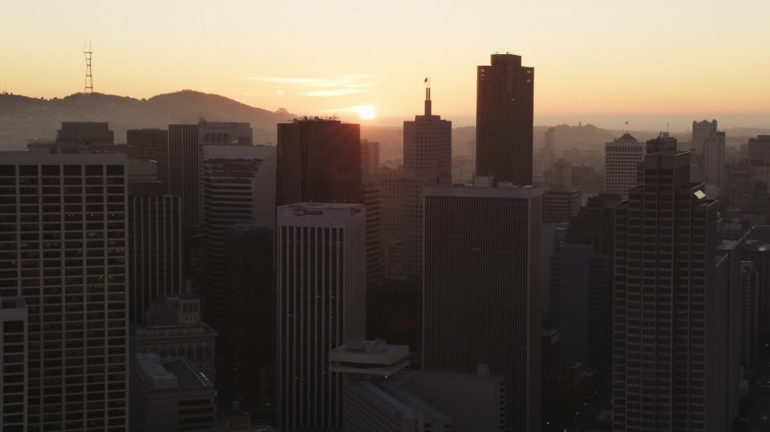 5K Aerial Video Setting sun behind skyscrapers in Downtown San Francisco, California, sunset Aerial Stock Footage | DCSF07_067