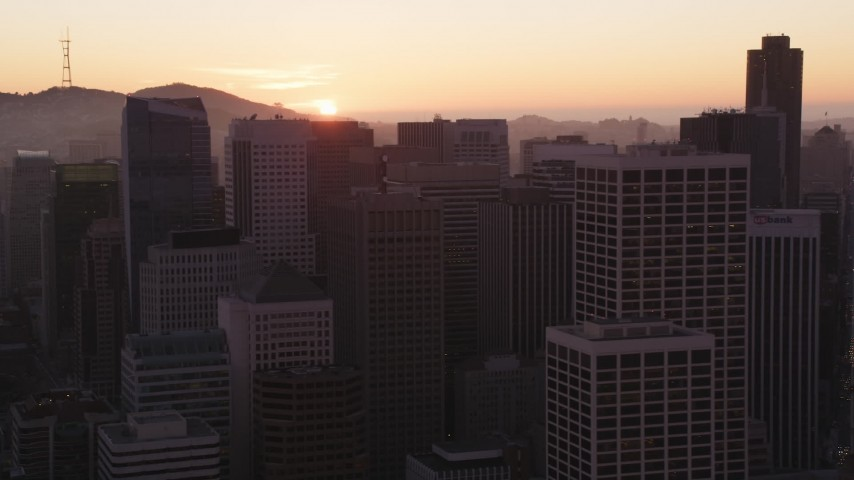 5K Aerial Video Setting sun behind Downtown San Francisco skyscrapers, California, sunset Aerial Stock Footage | DCSF07_068