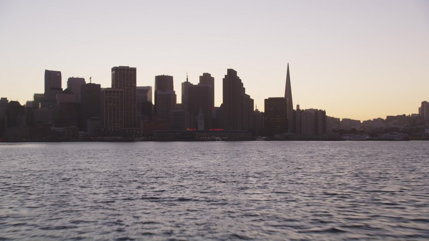 5K Aerial Video Low altitude approach to Ferry Building and Downtown San Francisco skyline, California, twilight Aerial Stock Footage | DCSF07_072