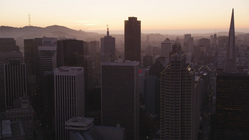 5K Aerial Video Fly over downtown to approach 555 California Street skyscraper, Downtown San Francisco, California, twilight Aerial Stock Footage | DCSF07_073