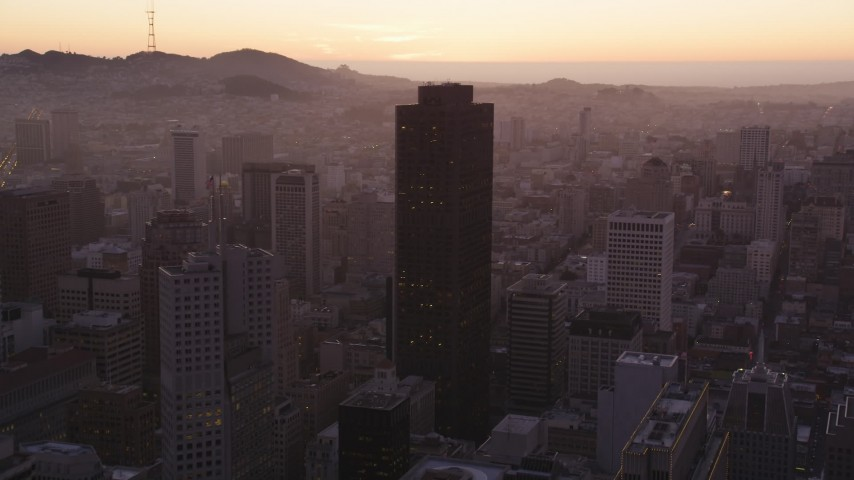 5K Aerial Video Approach and fly over 555 California Street skyscraper in Downtown San Francisco, California, twilight Aerial Stock Footage | DCSF07_074