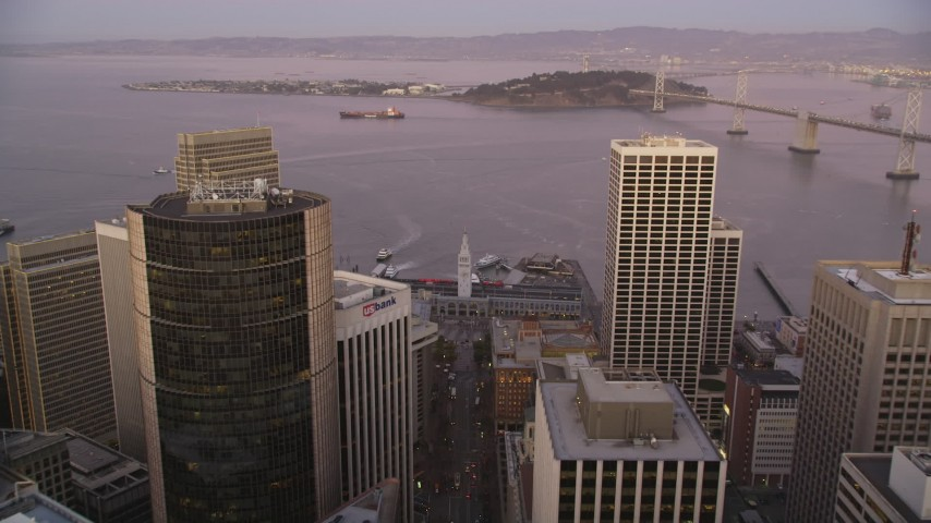 5K Aerial Video Approach and tilt to the Ferry Building and docked ferries, Downtown San Francisco, California, twilight Aerial Stock Footage | DCSF07_080