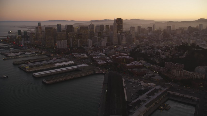 5K Aerial Video Fly away from piers, Coit Tower, and Downtown San Francisco, California, twilight Aerial Stock Footage | DCSF07_081