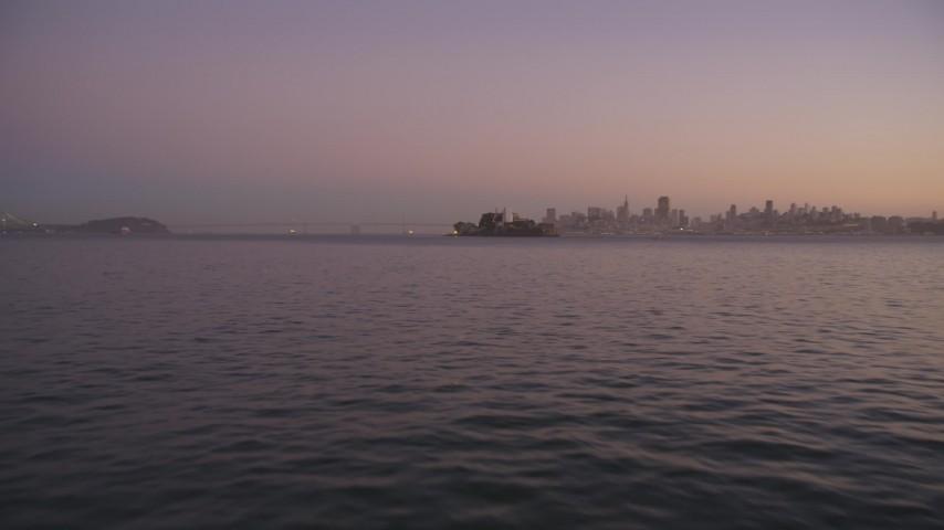 5K Aerial Video Low altitude approach to Alcatraz, San Francisco, California, twilight Aerial Stock Footage | DCSF07_083