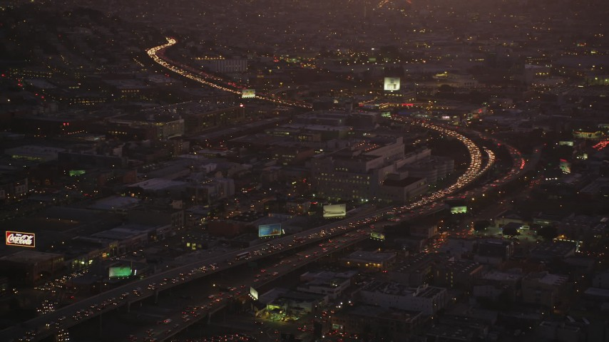 5K Aerial Video Heavy traffic on Interstate 80 by SFPD and County Jail, South of Market, San Francisco, California, twilight Aerial Stock Footage DCSF07_089   Axiom Images