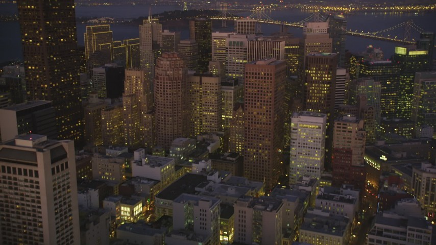 5K Aerial Video Tilt from city streets to reveal skyscrapers in Downtown San Francisco, California, night Aerial Stock Footage | DCSF07_092