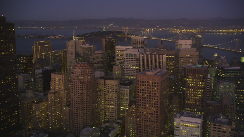 5K Aerial Video Fly over skyscrapers to approach the Bay Bridge, Downtown San Francisco, California, night Aerial Stock Footage | DCSF07_093