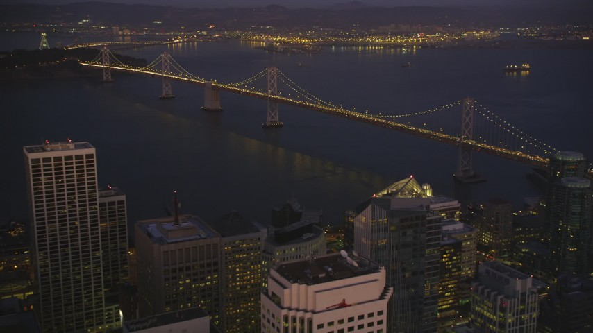 5K Aerial Video Approach and tilt to the Bay Bridge from Downtown San Francisco, California, night Aerial Stock Footage | DCSF07_094